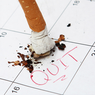 Cigarette butt on top of a calendar with the date circled and a written message saying